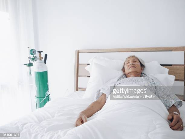 Female Patient Sleeping On Bed At Hospital