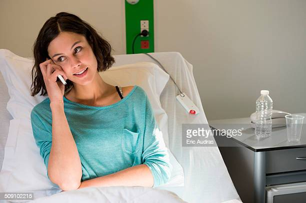Female patient talking on a mobile phone