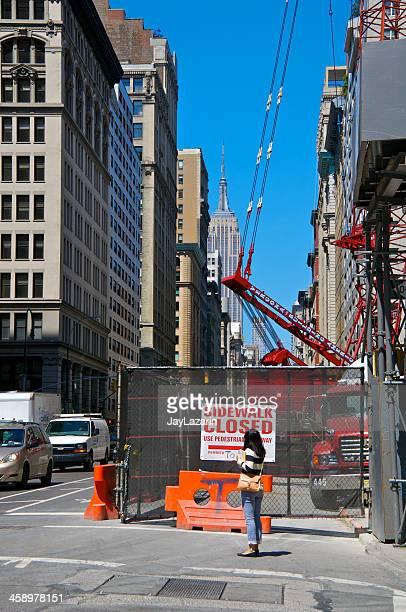 Female pedestrian near construction site, Manhattan, New York City