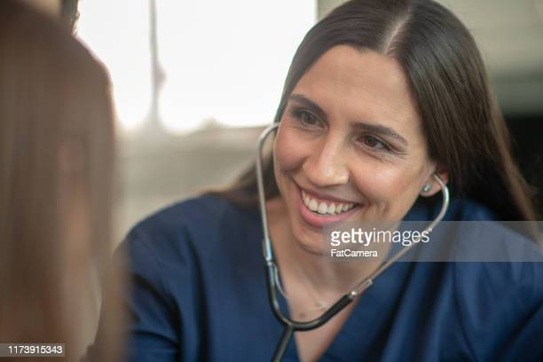 female pediatrician with patient - human internal organ stock pictures, royalty-free photos & images