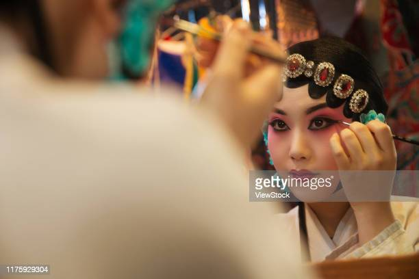 female peking opera actor backstage makeup - backstage stock pictures, royalty-free photos & images