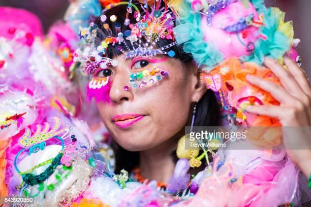 a female performance artist wearing a colorful hand made costume - bühnenschminke stock-fotos und bilder