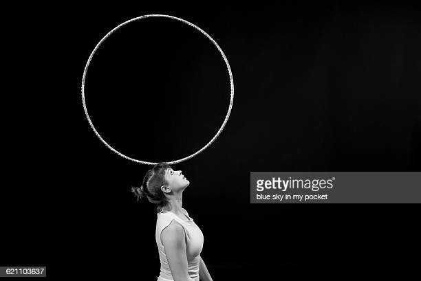female performer balancing a hoop - balance stock pictures, royalty-free photos & images