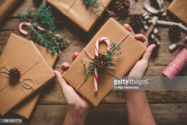 female person holding christmas gift - gift stock pictures, royalty-free photos & images