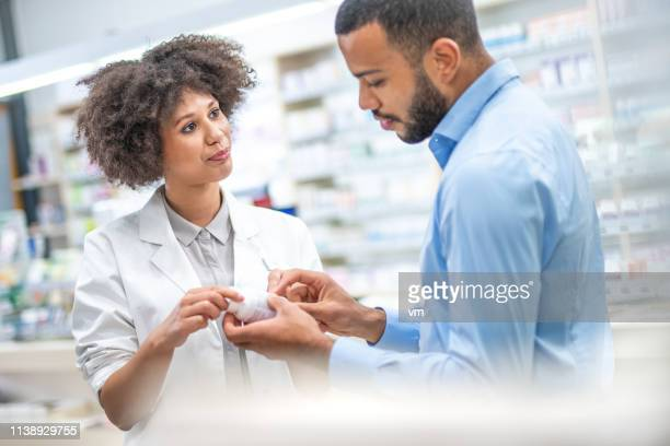 female pharmacist and customer - instructions stock pictures, royalty-free photos & images