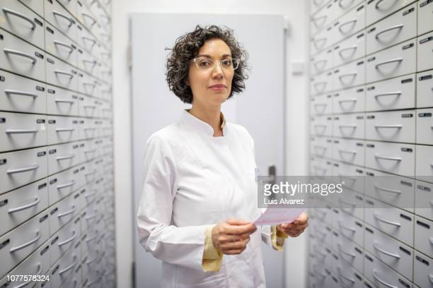 female pharmacists working in warehouse depot - three quarter length stock pictures, royalty-free photos & images