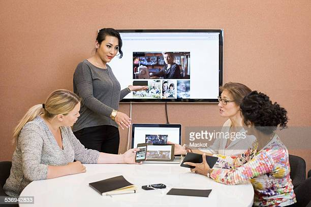 Female photo editors discussing in board room