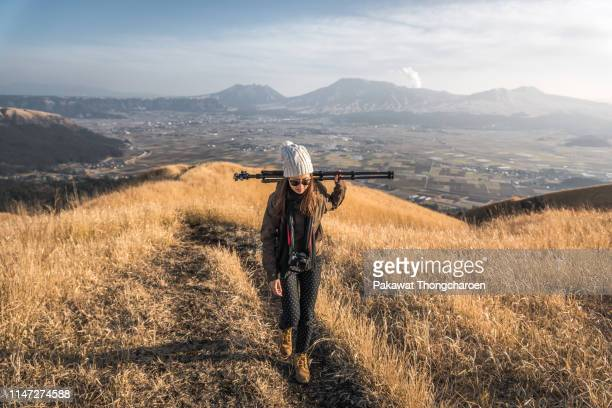 female photographer and view of mount aso from daikanbo viewpoint - 三脚 ストックフォトと画像