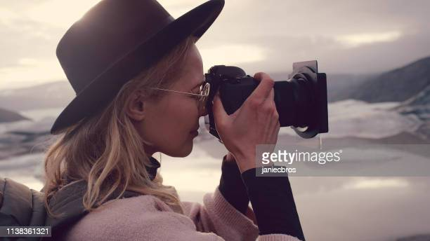 female photographer at glacier lagoon - photographer stock pictures, royalty-free photos & images
