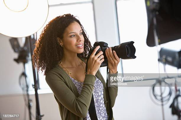 female photographer in studio - photographer stock photos and pictures
