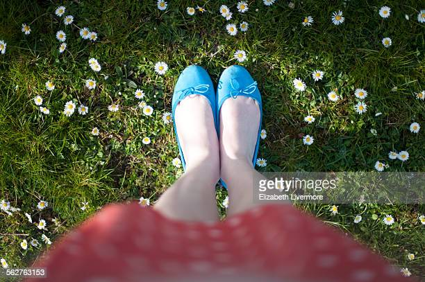 Female photographer looking down at feet