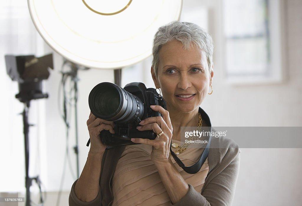 Female photographer : Stock Photo