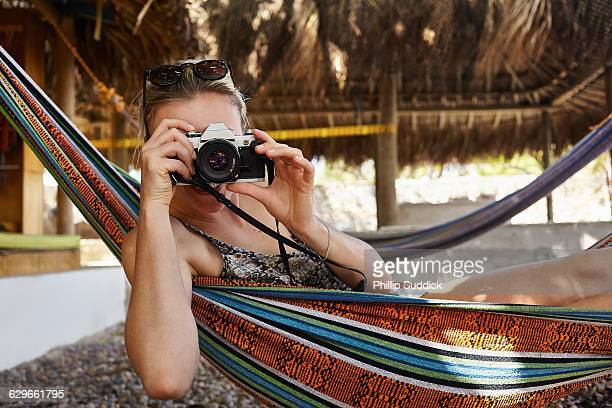 female photographer taking pictures in a tropical