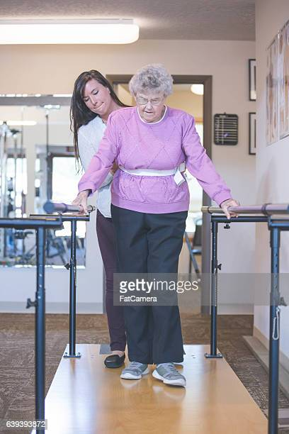 Female physical therapist working with a female senior