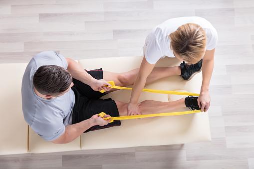Female Physiotherapist Giving Exercise Treatment 917896152