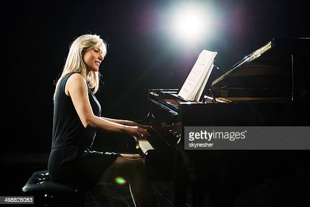 female pianist. - pianist stock pictures, royalty-free photos & images