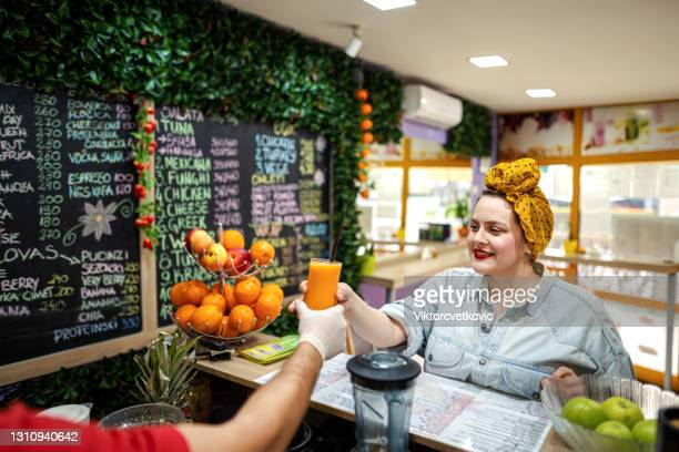female picking her smoothies - chubby credit stock pictures, royalty-free photos & images
