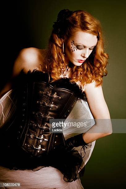 female - corset stock pictures, royalty-free photos & images