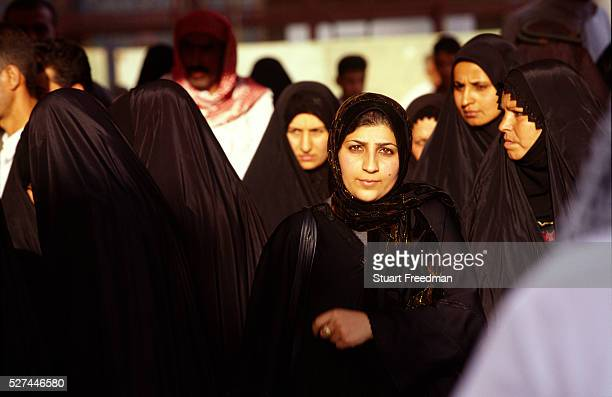 Female pilgrims attend the shrine in Karbala Iraq The shrine is holy to Shi'ite Muslims because it contains the tomb of Mashad al Hasayn bin Ali the...