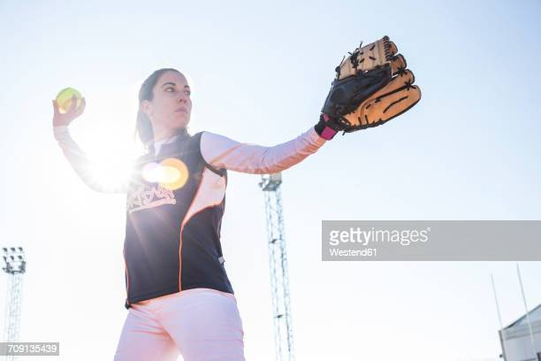 Female pitcher ready to throw the ball during a baseball game