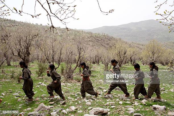 Female PJAK guerrillas demonstrate their regime of physical exercise in their camp situated in the mountains on the Iran Iraq border The PJAK is a...