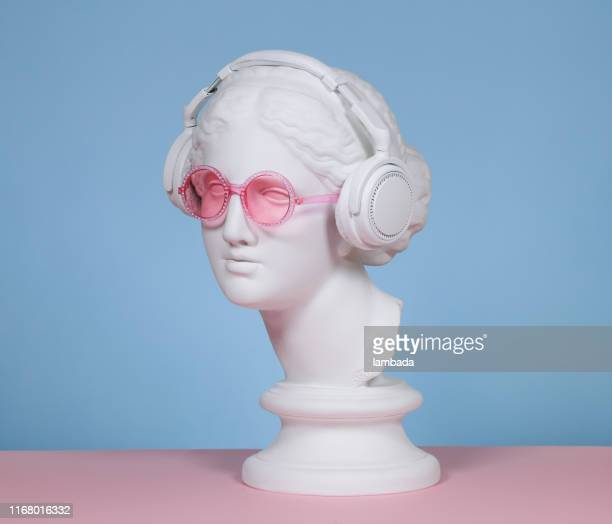 female plaster head with headphones and eyeglasses - greek culture stock pictures, royalty-free photos & images
