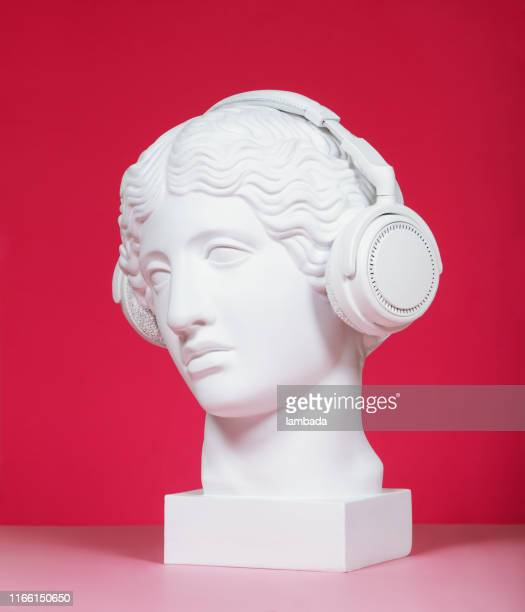 female plaster head with headphones - sculpture stock pictures, royalty-free photos & images