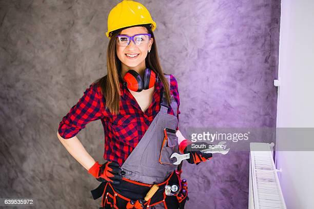Female plumber in home renovation