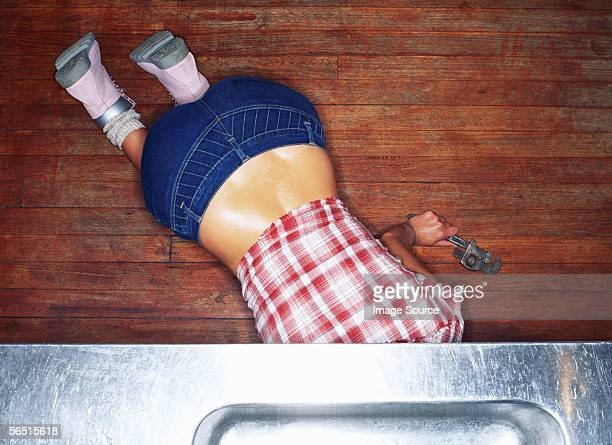 female plumber - metallic shoe stock pictures, royalty-free photos & images