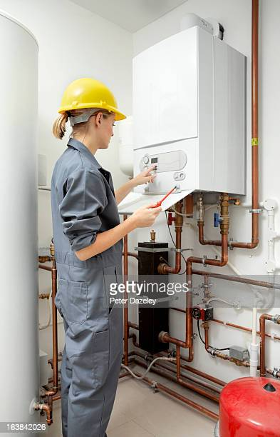 female plumber with boiler