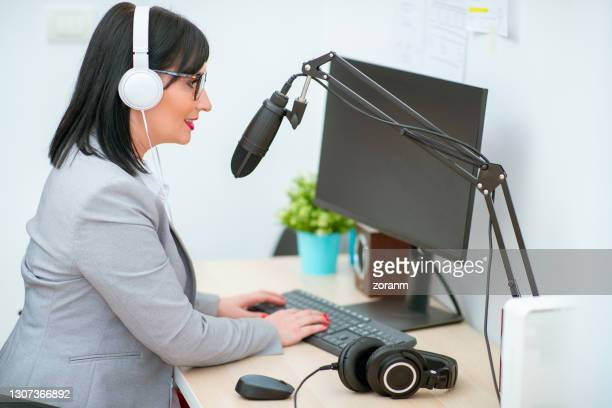 female podcaster behind microphone - journalist stock pictures, royalty-free photos & images