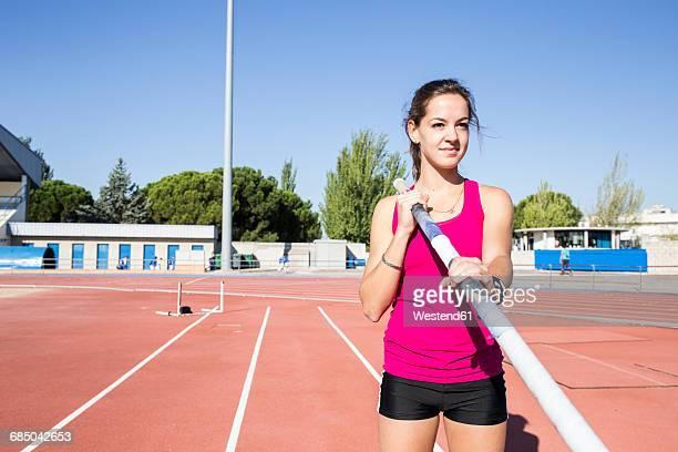 Female pole vaulter preparing