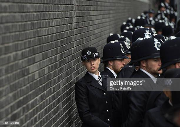 A female police cadet looks down a line of cadets as they prepare to start the Metropolitan Police 'Passing Out Parade' outside Peel House at Hendon...