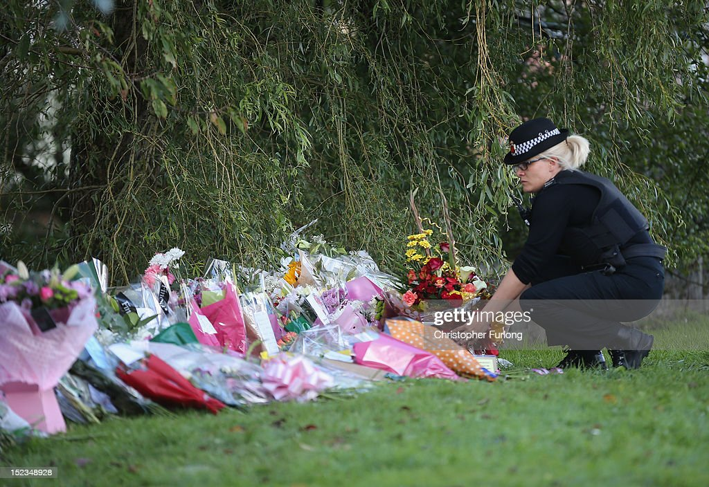 A female police constable pay her respects and places a floral tribute in memory of WPC's Nicola Hughes and Fiona Bone in Hattersley on September 19, 2012 in Manchester, England. Local man Dale Cregan, 29, has been arrested in connection with the shooting of WPC's Nicola Hughes and Fiona Bone, who were killed as they responded to a routine incident at Abbey Gardens in Hattersley shortly before 11am yesterday.
