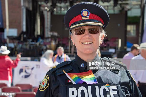 Female police officer enjoying Pride celebrations in downtown Toronto city
