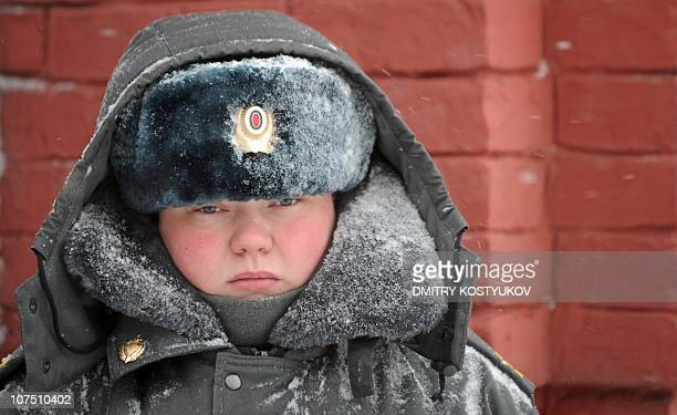 A female police officer stands guard on Red Square in Moscow on December 9 2010 after Moscow was hit by a snow fall AFP PHOTO / DMITRY KOSTYUKOV