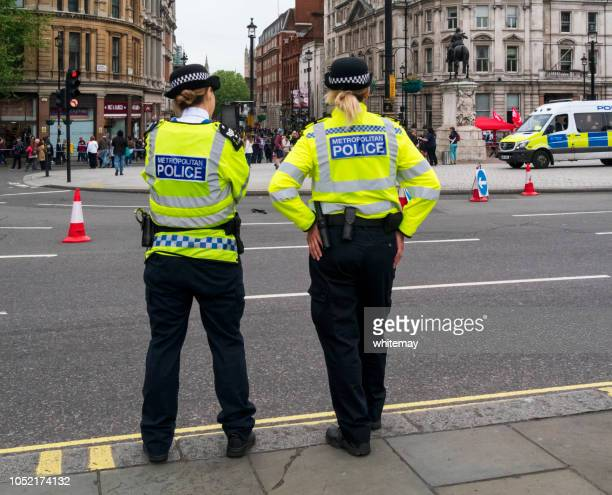 female police officers on duty in london - metropolitan police stock pictures, royalty-free photos & images