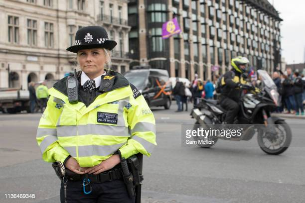 Female police offices as motorcyclists gather outside Westminster protesting against the Bloody Sunday prosecution of Soldier F on April 12 2019 A...