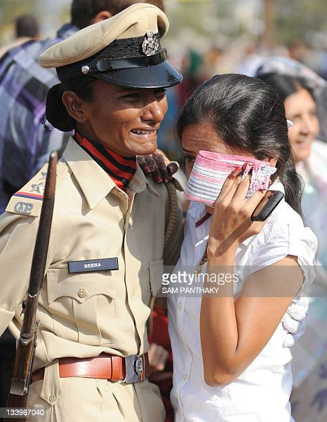 A female Police SubInspector reacts as she meets her friend after a passing out parade at the Gujarat Police Academy in Karai near Gandhinagar around...