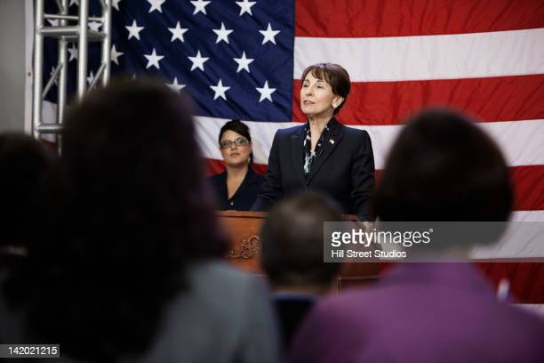 female politician making speech at podium - homme politique photos et images de collection