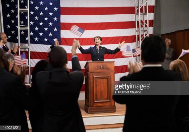 female politician making speech at podium - 政治家 ストックフォトと画像