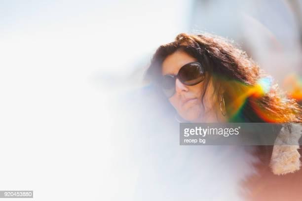 Female portrait in the sun