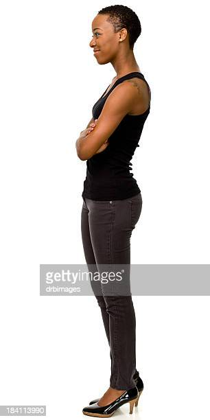 female portrait of woman standing sideways in heels - black pants stock pictures, royalty-free photos & images