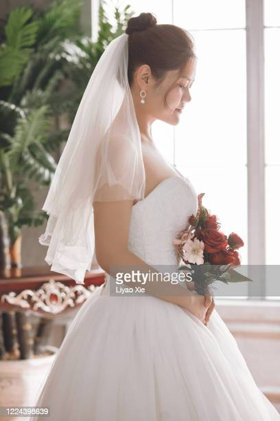 female potrait in wedding ceremony - liyao xie stock pictures, royalty-free photos & images