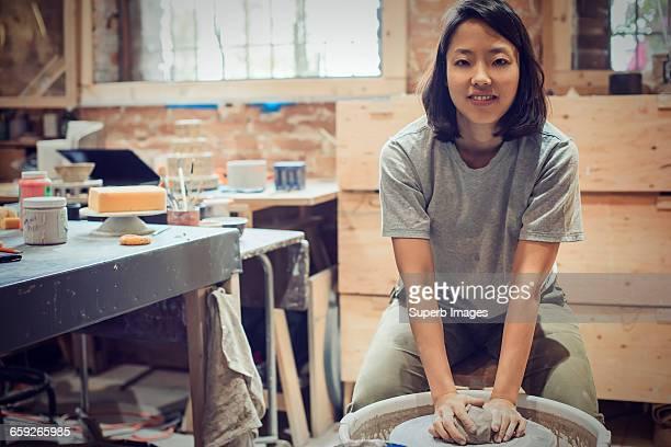 Female potter portrait in workshop