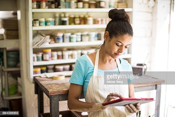 female potter working in her studio - leanincollection working women stock photos and pictures