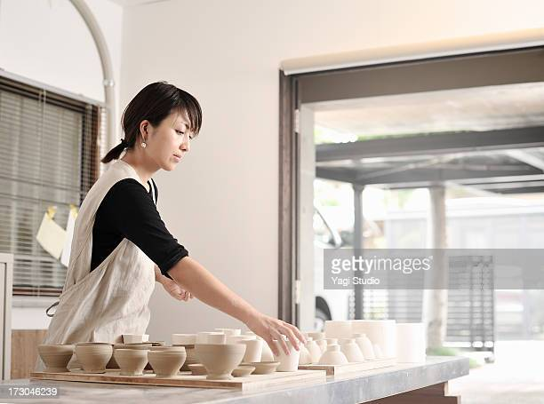 Female Potter working in studio,Kyoto,Japan