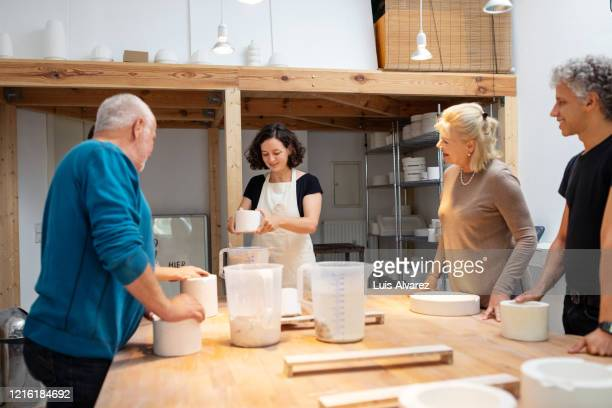 female pottery maker conducting workshop - instructor stock pictures, royalty-free photos & images