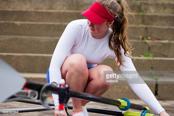 Female Prepares Her Boat For Row