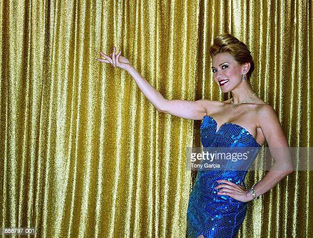 female presenter in blue sequinned dress (cross-processed) - television host stock pictures, royalty-free photos & images